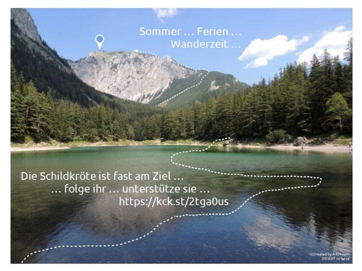 Berg+See-Panorama mit einer Wanderspur bis fast unter den Gipfel!